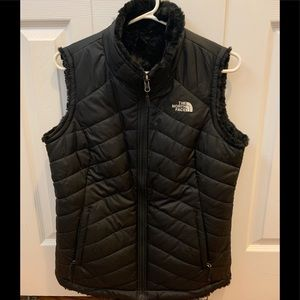 The North Face reversible puffer / fur vest medium